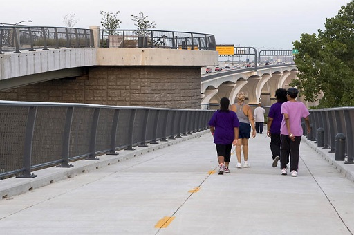Four people walking on the Woodrow Wilson Bridge Trail
