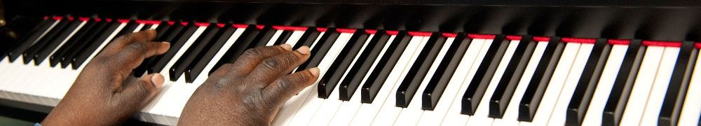 Close up of two hands playing the piano