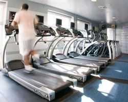 man running on a treadmill at the rollingcrest chillum community center fitness room