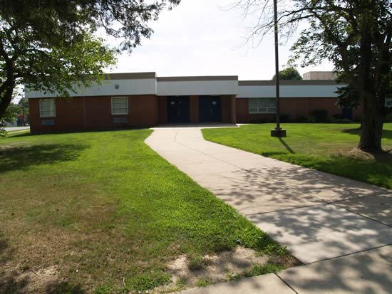 Elementary School exterior with sidewalk leading to door